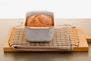Freshly baked banana bread in a loaf tin