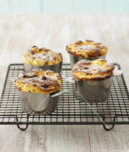 Quark soufflés sprinkled with icing sugar on cake rack