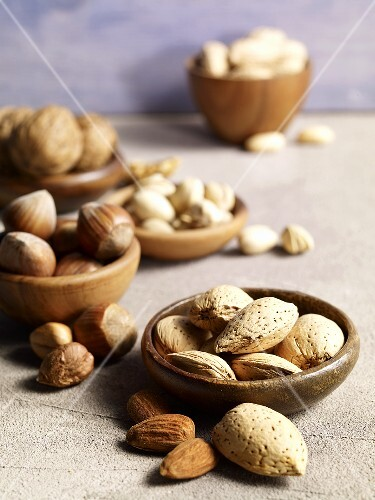 Different kinds of nuts in bowls