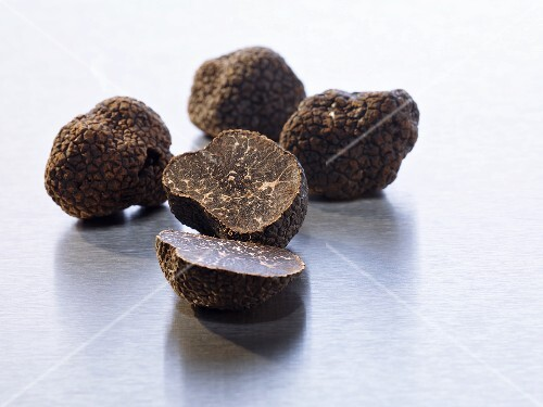 Black truffles, whole and halved