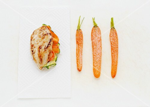 A chicken breast stuffed with cucumber and carrots