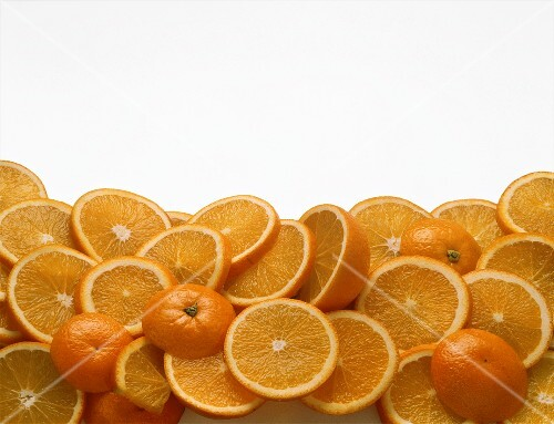 Slices of orange on sheet of glass