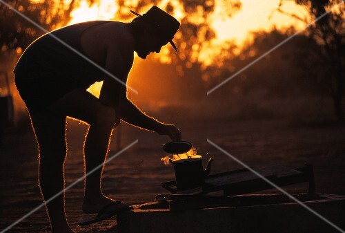 A Man Making Tea at Campsite in Australia