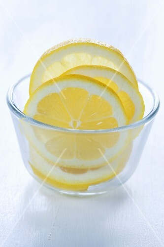 Lemon slices in a glass bowl