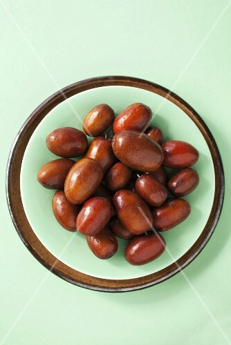 Jujube fruits in a bowl, seen from above