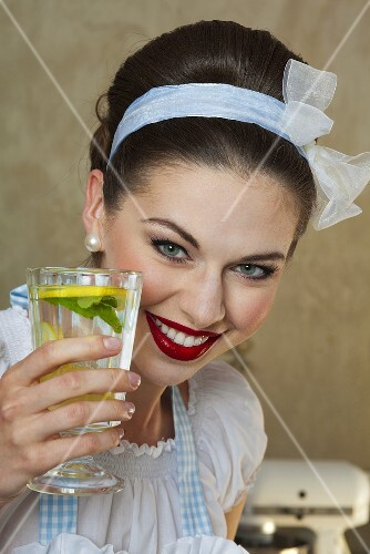 A retro-style girl holding a glass of lemonade