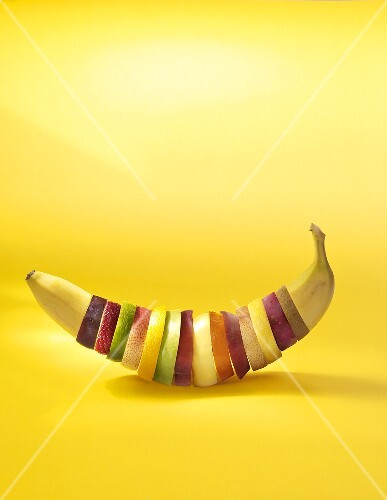 Various slices of fruit shaped into a banana