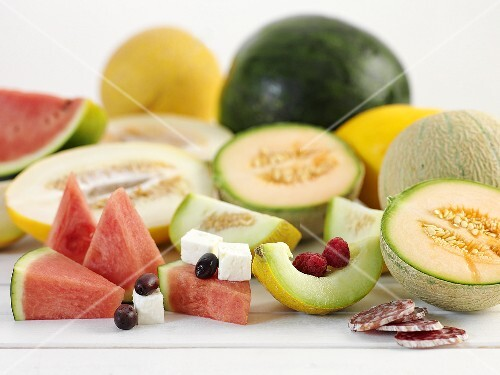 Various types of melon with feta and salami