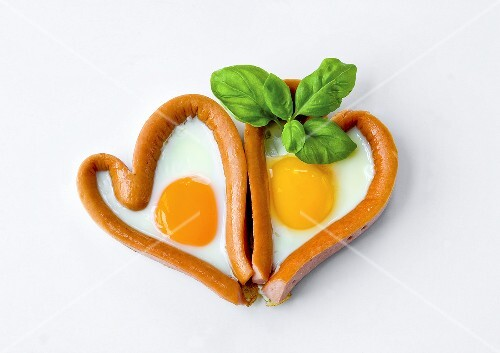 Two sausage and fried egg hearts