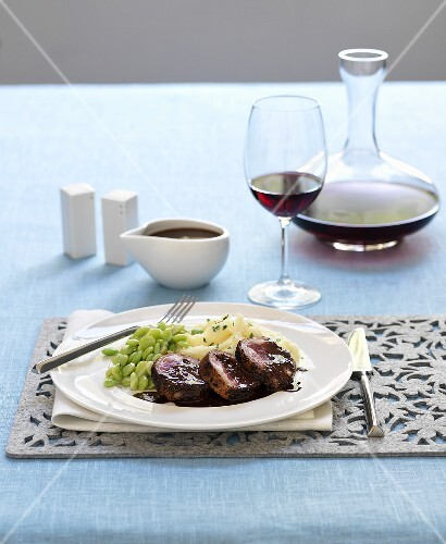 Lamb shoulder with chocolate sauce, mashed potatoes and lima beans
