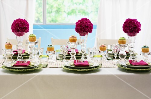 A festively laid table with flower balls
