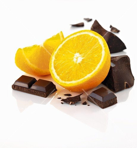 An orange and pieces of chocolate