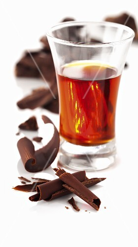 Liqueur in a glass with chocolate curls