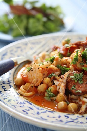 Chickpea stew with seafood and chorizo