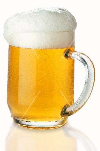 Lager in tankard, frothing over (1)