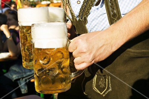 Man in national dress with 3 litres of beer (Oktoberfest, Munich)