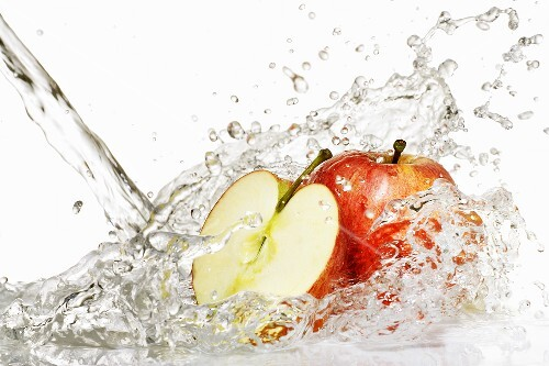 Fresh apples in a jet of water
