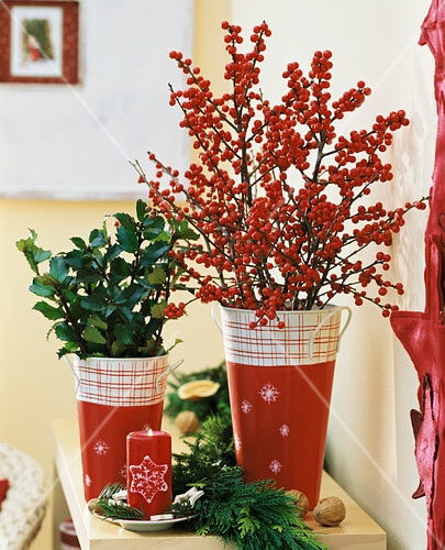 Vases of red berries and holly