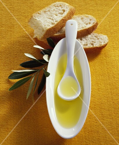 Olive oil, ciabatta and olive branch