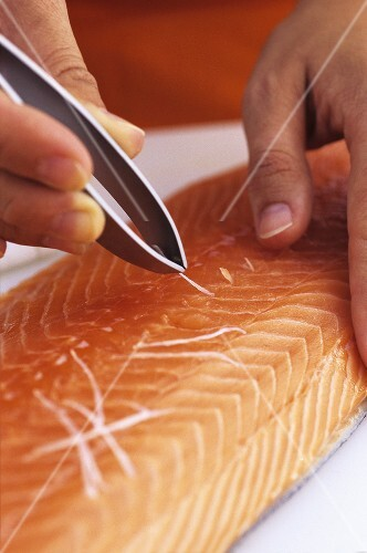 Removing the pin bones from a salmon fillet