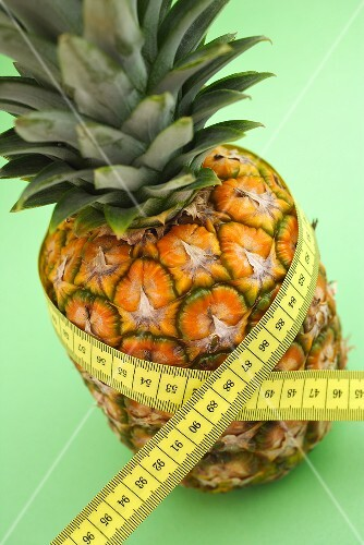 Pineapple with tape measure