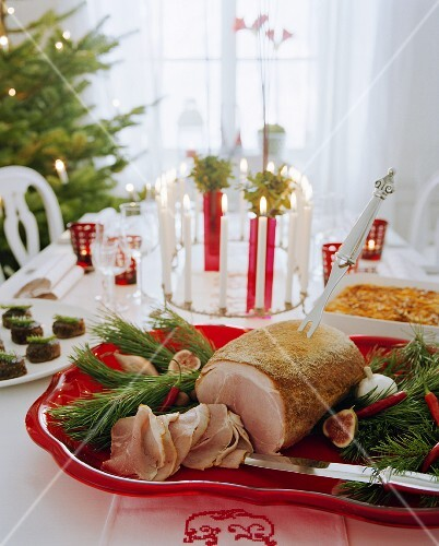 Christmas table with roast ham