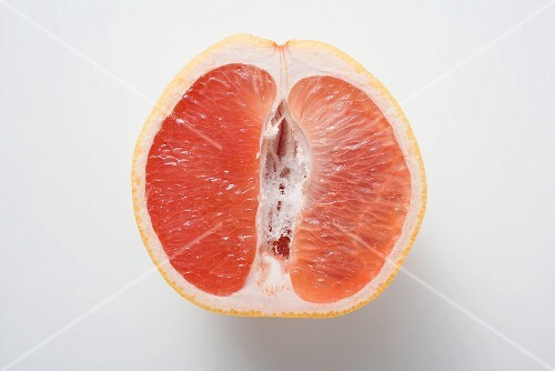 Half a pink grapefruit (longitudinal section)