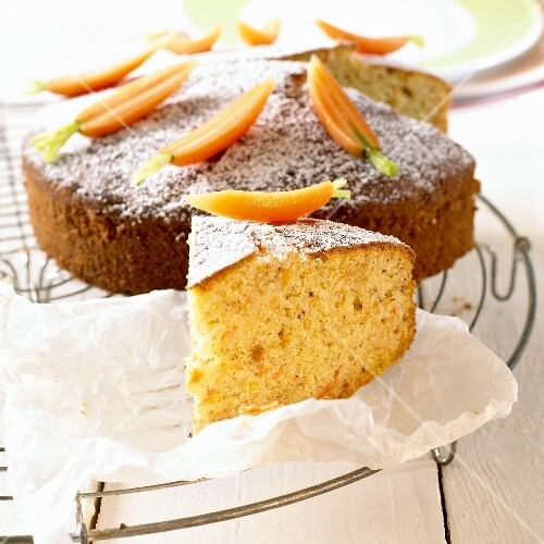 Carrot cake decorated with fresh carrots
