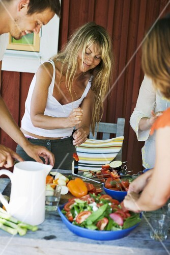 Friends preparing food for barbecue
