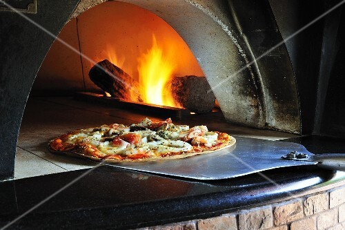 Seafood pizza in stone oven