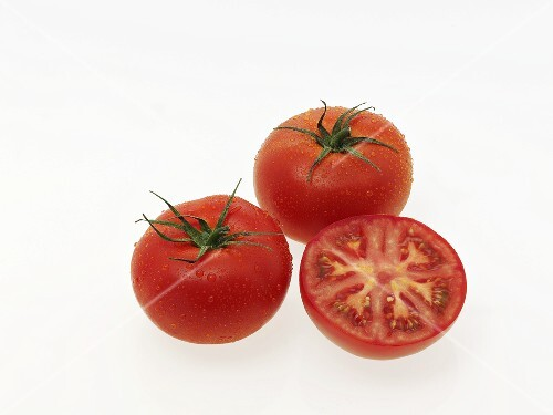 Two whole tomatoes and a half tomato