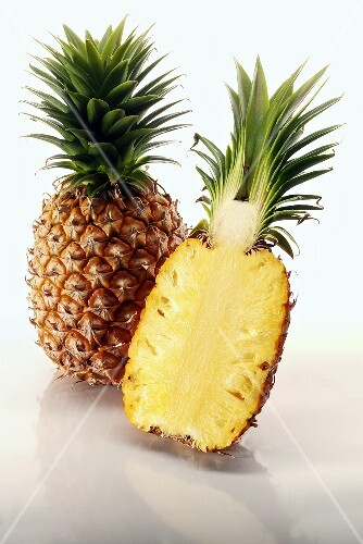 One whole pineapple and half a pineapple