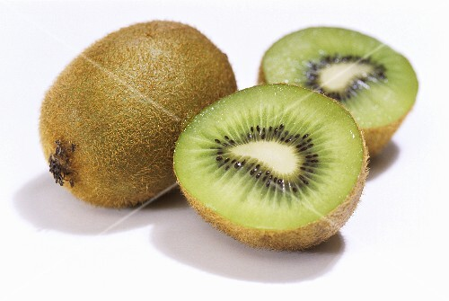 Kiwi fruit, one whole and one halved