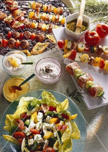 Mixed kebabs for grilling, sauces and mixed salad