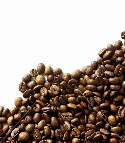 Coffee beans against white background