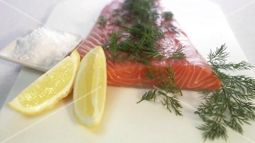 Gravlax with lemon, dill and salt (close-up)