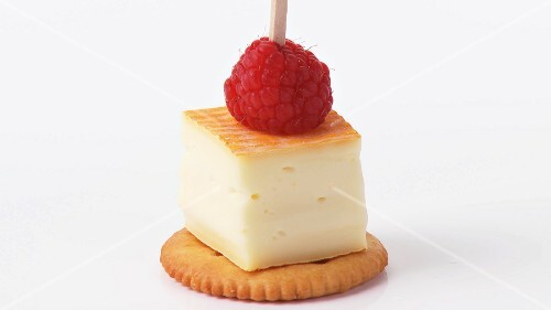 Washed rind cheese & raspberry on cocktail stick on cracker