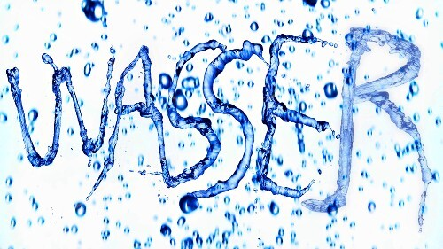 The word 'Wasser' ('water' in German) written in water with splashes
