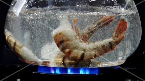 Prawns falling into boiling water