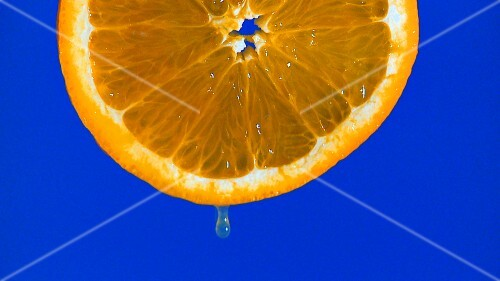 Dripping slice of orange