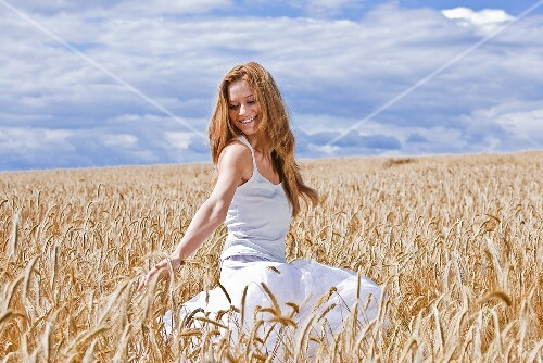 Young woman in barley field