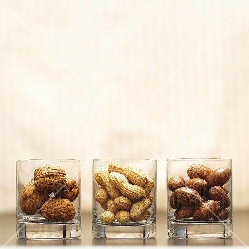 Different types of nuts in glasses