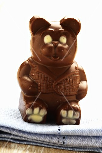Chocolate bear on fabric napkin