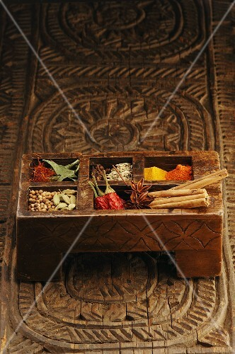 Assorted spices in Indian wooden box