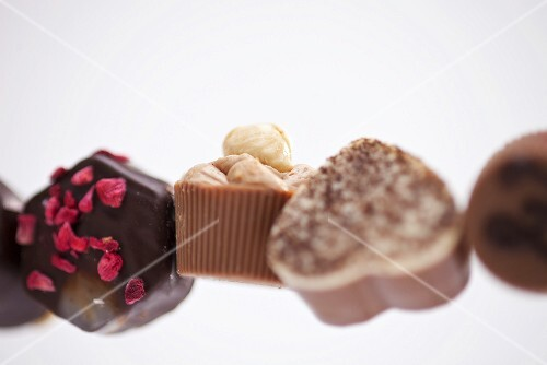Row of assorted chocolates (close-up)