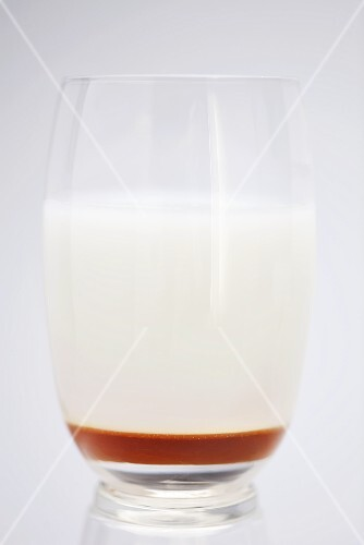 A glass of whey with honey
