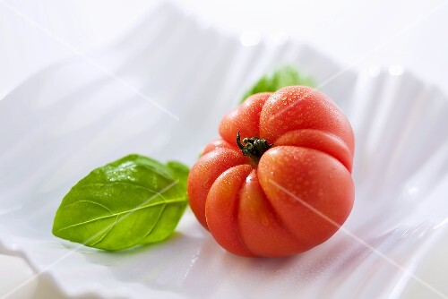 Oxheart tomato and basil in ceramic dish