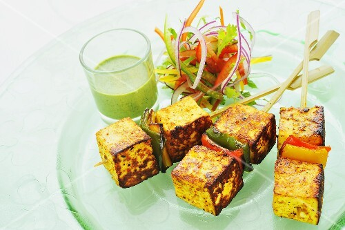 Paneer tikka (Indian cheese dish) with a mint dip