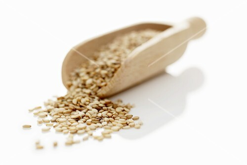 Sesame seeds in a wooden scoop