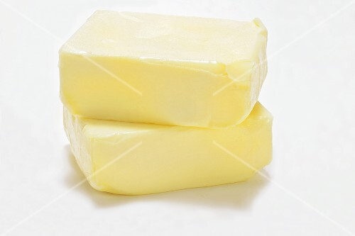 Two blocks of butter, one on top of the other